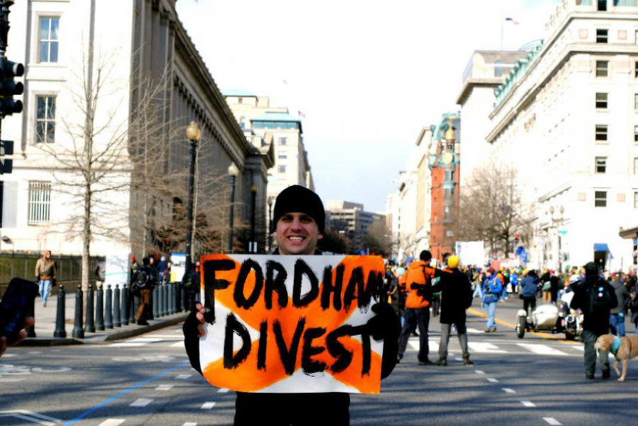 An advocate for Fossil Free, pictured above, advocates for the divestment of Fordham's endowment from fossil fuels (Photo Courtesy of Facebook).