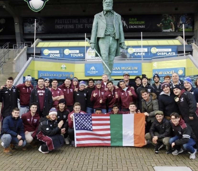 The team poses with an American and Irish flag in front of the Gaelic Athletic Association Museum in Croke Park. (Courtesy of Fordham Rugby)