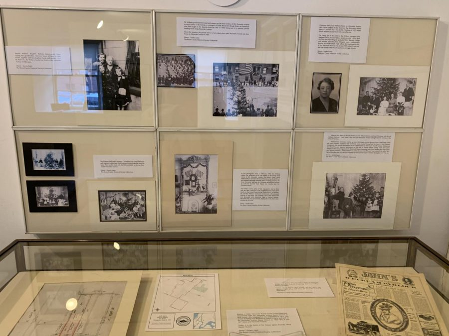 The exhibit, pictured above, is mainly made up of photographs detailing the architecture and layout of Mott Haven. (Gracie Davis/The Fordham Ram)