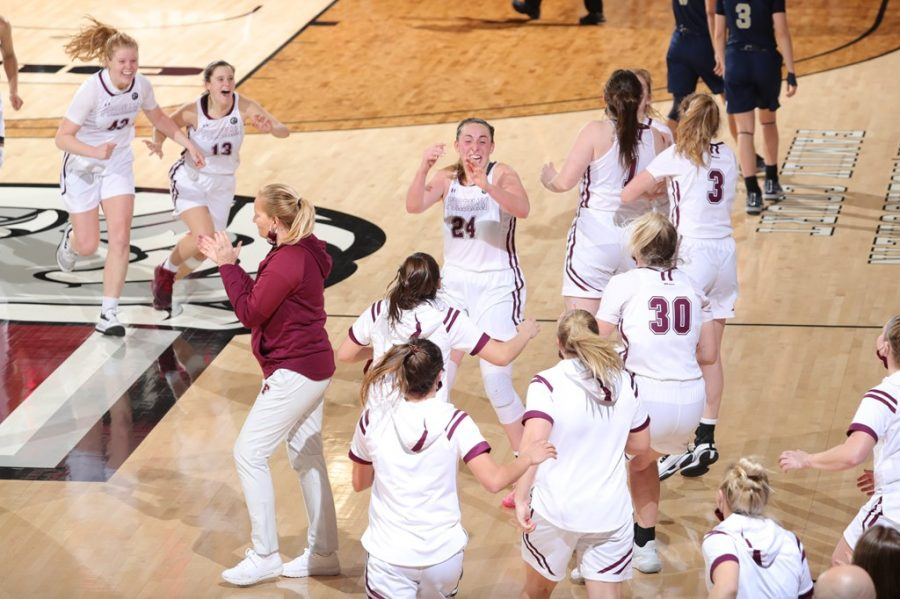 Women's Basketball celebrated a late three from Anna DeWolfe to win their third game in a row. (Courtesy of Fordham Athletics)