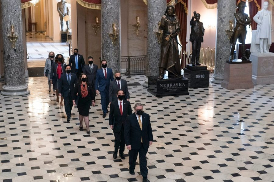 Impeachment+managers+walk+through+Statuary+Hall+of+the+Capitol+on+the+way+to+the+Senate+trial.+%28Courtesy+of+Courthouse+News%29