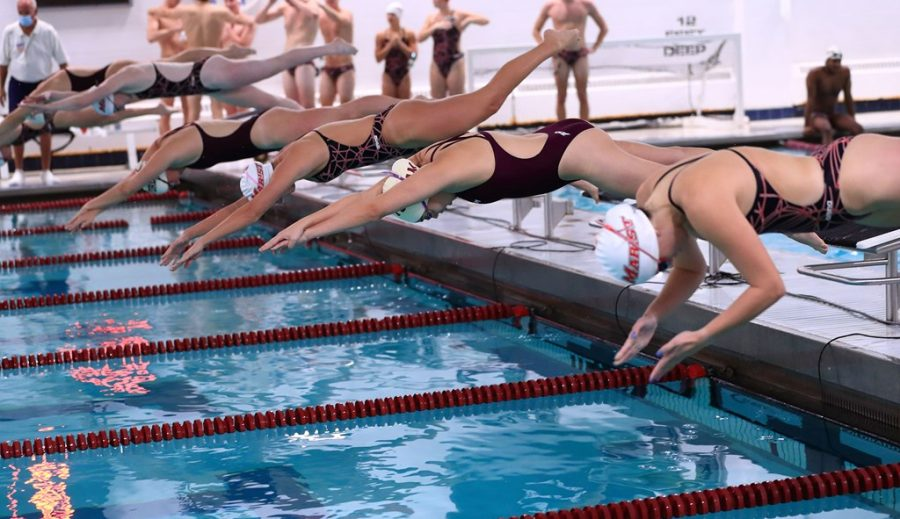 Fordham and Marist take the water for the 200 freestyle, with junior Clare Culver finshing on top of her opposition. (Courtesy of Fordham Athletics)