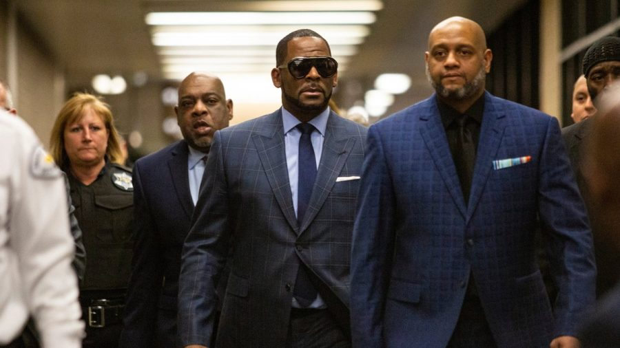 R. Kelly (center) was recently found guilty of sex trafficking and racketeering after sexually abused minors speak out. (courtesy of Twitter)