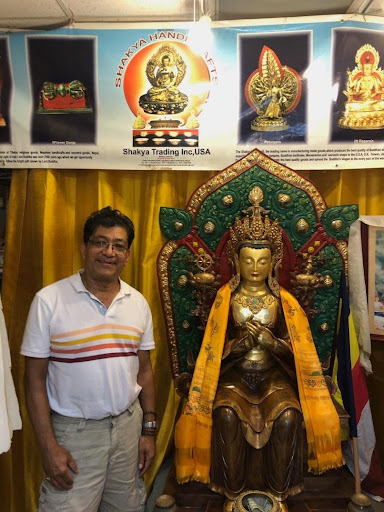 Sagar Shakya and the Maitreya Buddha. (courtesy of Ryan Heffron for the Fordham Ram)